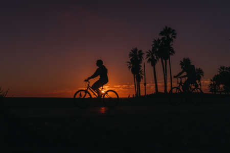 Los Angeles, USA - September 27, 2015: People are walking at the sunset on the Venice beach, California.