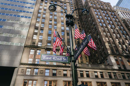 New York, USA - September 23, 2015: American flags in New York. Corner of East 42nd Street and Vanderbilt Avenue. Editorial