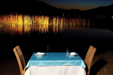 Dinner on lakeside with blue tablecloth photo
