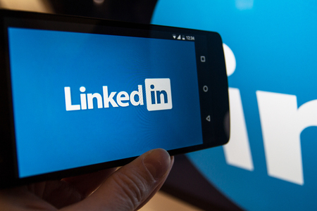 MOSCOW, RUSSIA - February 2,2017: Smartphone with Linkedin.com homepage on the screen. LinkedIn is a business-oriented social networking service Editorial