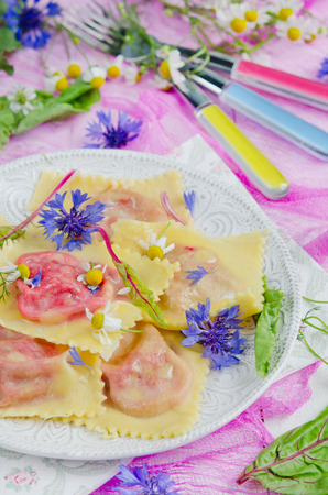 chese: Ravioli with beets and ricotta chese on the colorful backgrond Stock Photo