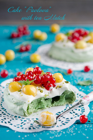 Cake  Pavlova  with tea Match, and fresh berries photo