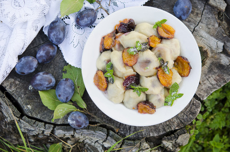 Delicious sweet dumplings stuffed with fresh plums photo