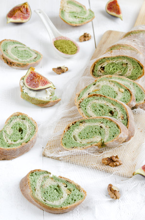 Green tea bread with almonds on white background photo