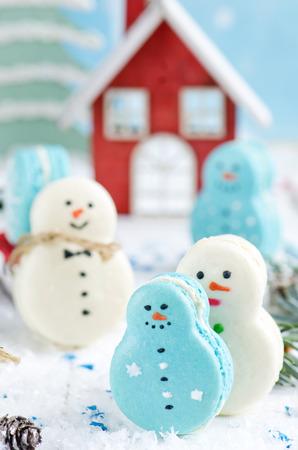 Christmas makarons with chocolate ganache on white background photo