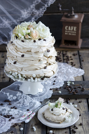 extravagance: Pavlova with coffee and whipped cream on wooden background