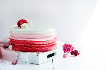 wedding table decor: Delicious wedding cake decorated with with ribbon