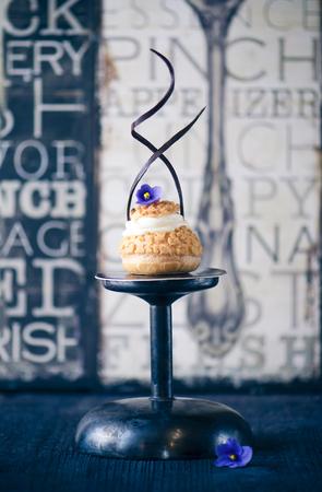 choux: Fresh choux pastry on dark wooden background
