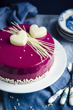Cake Black Currant. Honey cake with cinnamon, black currant confit, vanilla and lemon butter cream, mousse, mirror glaze