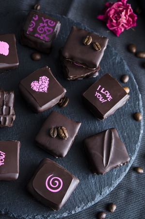 fancy sweet box: Handmade luxury chocolate with crunchy hazelnut praline and coffee. dark bachground Stock Photo
