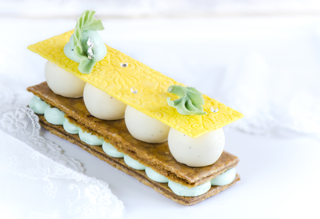 napoleon dessert: Millefeuille with pear ganache cream and fresh mint