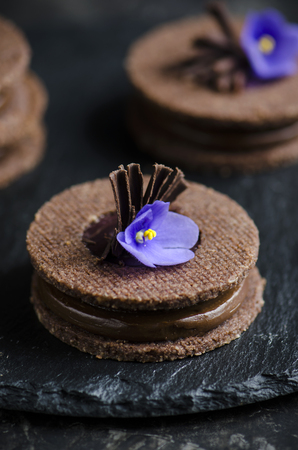 ganache: Chocolate cookies with chocolate ganache and violet Stock Photo