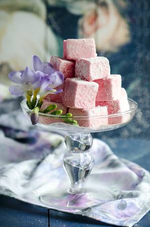 Strawberry marshmallow ,gimov, on a stand on a light background Stock Photo