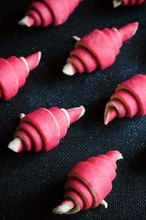 buttery: Raspberry croissant on a dark wooden background