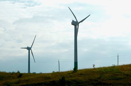 Wind power generators. Against the blue sky on an autumn day. Environmentally friendly technology. Imagens