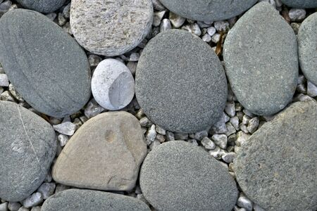 The background of stones of large smooth flat soured horizontally carpeted.
