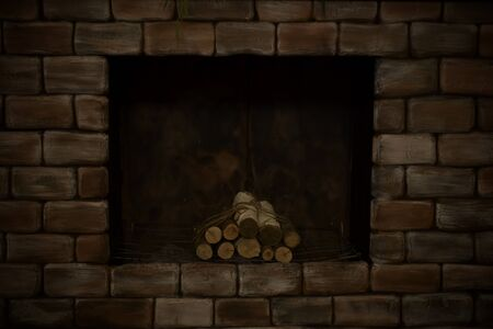 A mould of decorative fireplace made of aged brick with birch logs in the twilight. Banque d'images