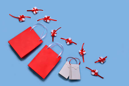 Paper bags are shopping bags for red and white on a light blue background
