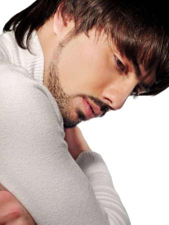 Thinking man on the white background photo