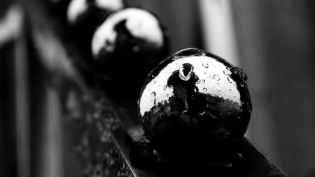 orbs: Metal orbs splattered with water