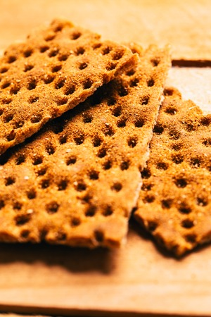 fresh buckwheat crackers on a wooden background.