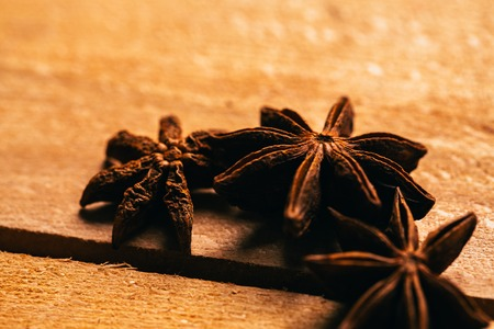 anis: star anise spice whole on a wooden background. Stock Photo