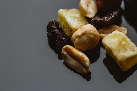mixture: mixture of nuts and dried fruits on a dark background.