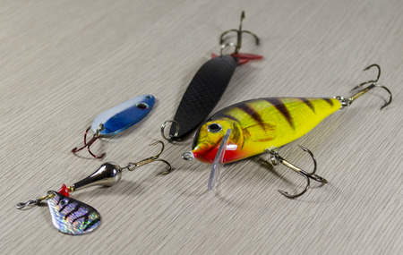 baits: Fishing baits on wooden background. Set. Stock Photo