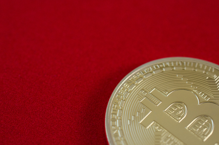 Golden Bitcoins (digital virtual money) on red background. Zdjęcie Seryjne
