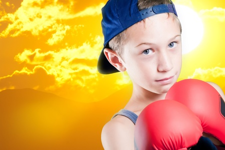 child with boxing boxing gloves fights for a best future Stock Photo - 10659599
