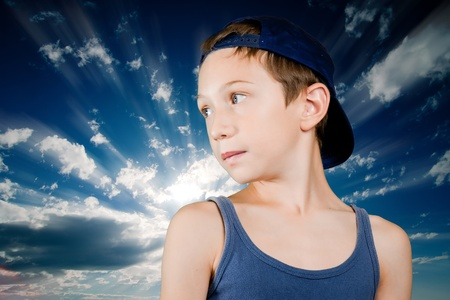 young boy over blue radious sky Stock Photo - 10659601