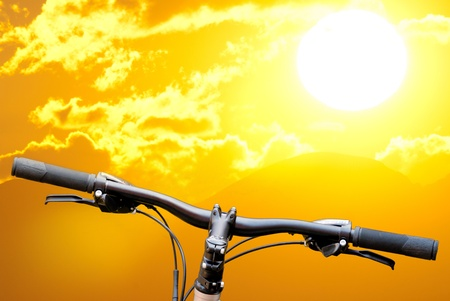 damper: mountain bike on landscape background Stock Photo