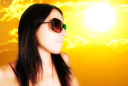 woman with sunglasses and big sun Stock Photo - 10707018