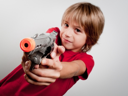 little boy with gun toy photo