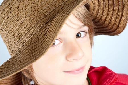 impassive: smiling caucasian child with hat
