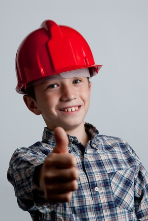 positiveness: child with red helmet and ok sign