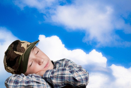 aon: child that dream aon blue sky background