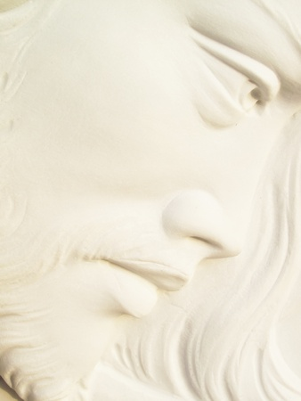 jesus face: jesus christ on white marble tombstone