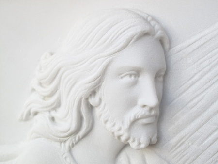 jesus christ on white marble tombstone photo