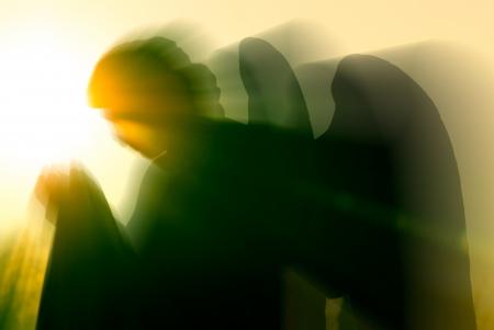ange gardien: ange et une lumi�re intense Banque d'images