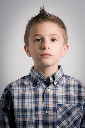 impassive: impassive boy expression Stock Photo
