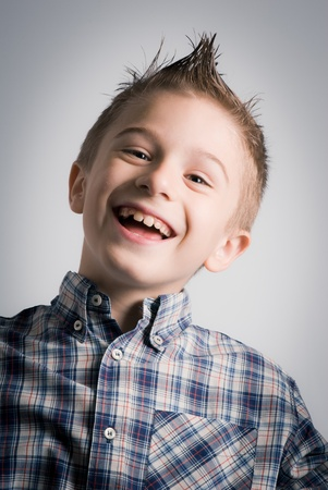 laughing boy expression Stock Photo - 13180065