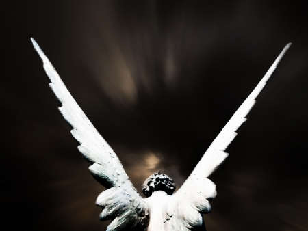 grave site: angel and dark sky Stock Photo