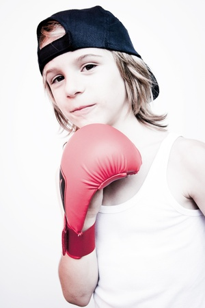 cute little boy with boxing gloves photo
