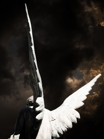 angel headstone: angel and dark sky Stock Photo