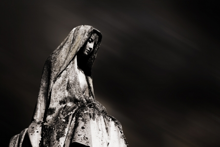 grave site: virgin mary and dark sky