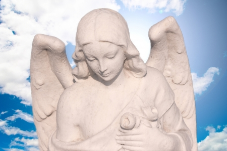 angel headstone: angel on blue sky Stock Photo