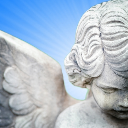 cherub: angel on blue stardust Stock Photo