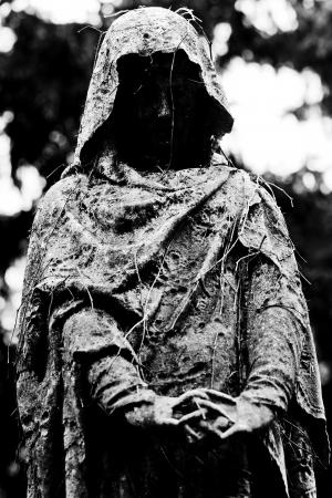 grim: ancient tombstone Stock Photo