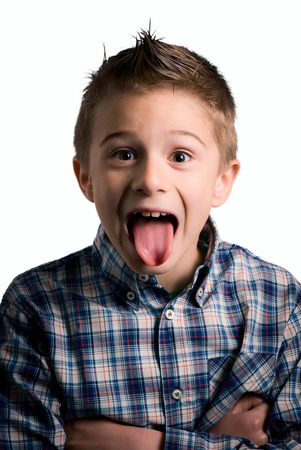 kid tongue out isolated on white photo